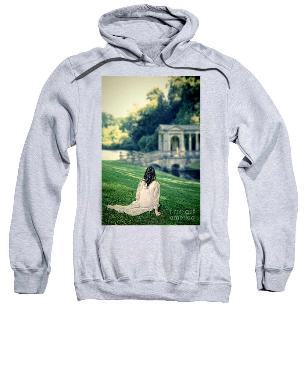 Lady Sweatshirt featuring the photograph Lady Sitting On A Hill Above A Lake by Jill Battaglia