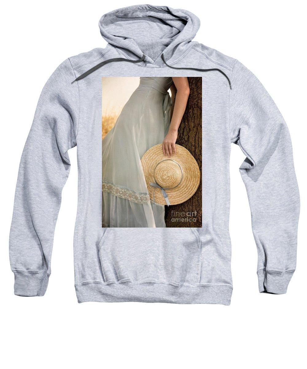 Caucasian; Female; Woman; Lady; Dress; Prairie; Hat; Arm; Body; Torso; Ribbon; Blue; Spring; Summer; Pastel; Beautiful; Lace; Pretty; Delicate; Prim; Proper; Feminine; Tree; Leaning; Wheat; Field; Nature; Straw; Thin; Skinny Sweatshirt featuring the photograph Leaning Beauty by Margie Hurwich