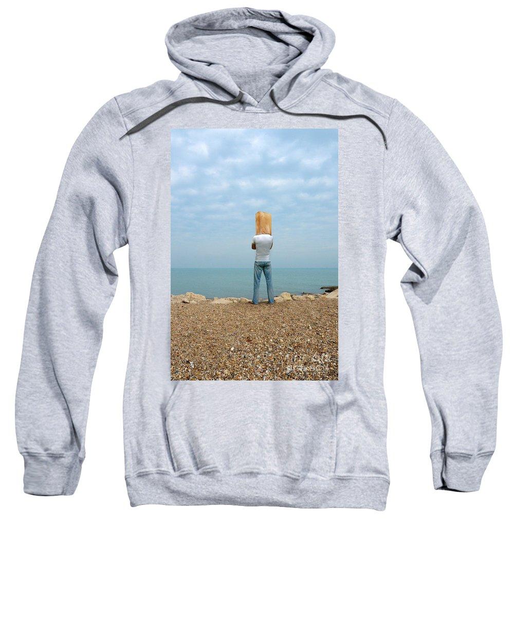 Beach Sweatshirt featuring the photograph Man By The Sea With Bag On His Head by Jill Battaglia