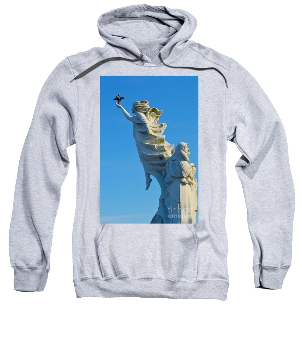 Immigrants Sweatshirt featuring the photograph Monument To The Immigrants Statue 1 by Alys Caviness-Gober