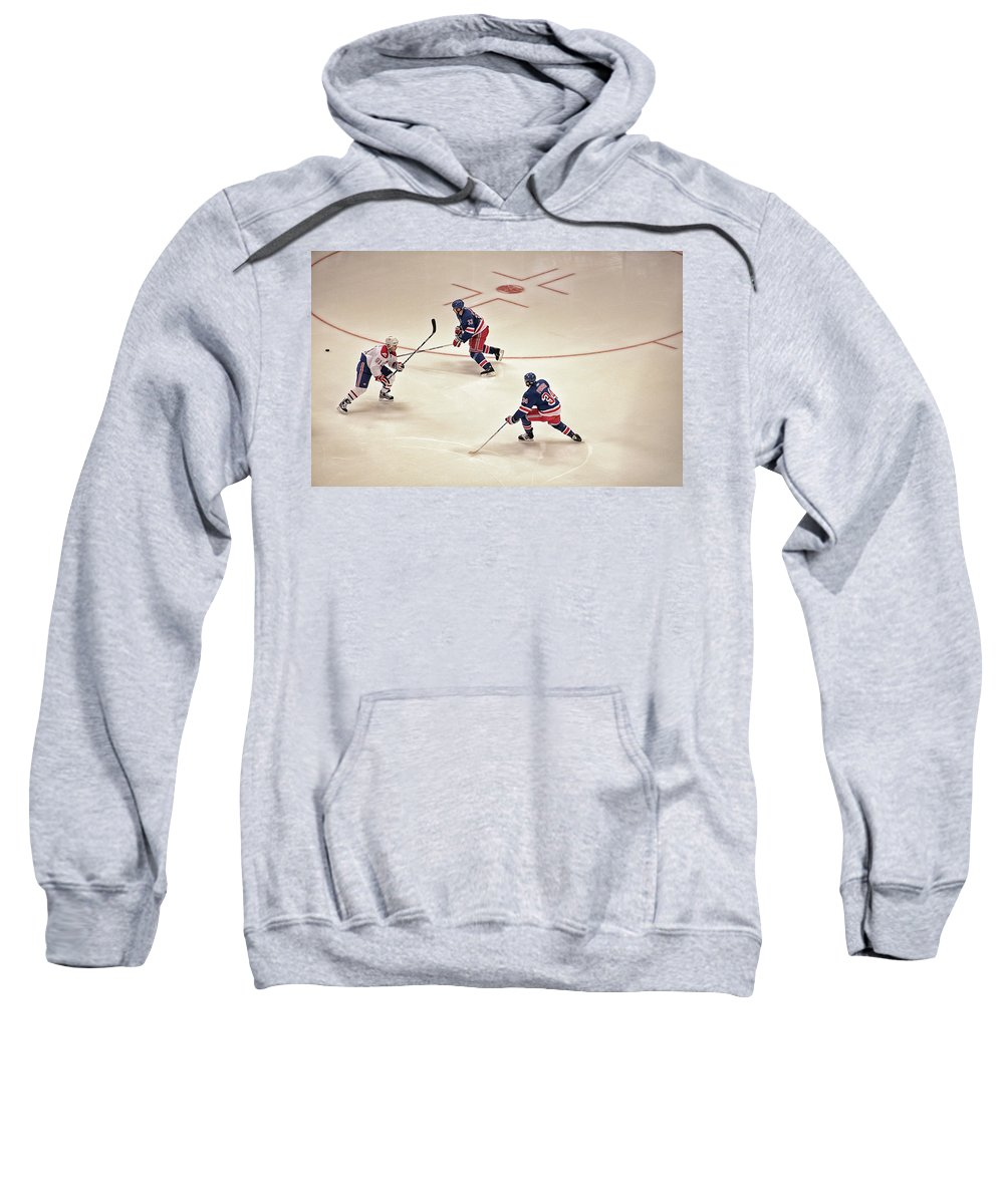 Hockey Sweatshirt featuring the photograph On The Offense by Karol Livote