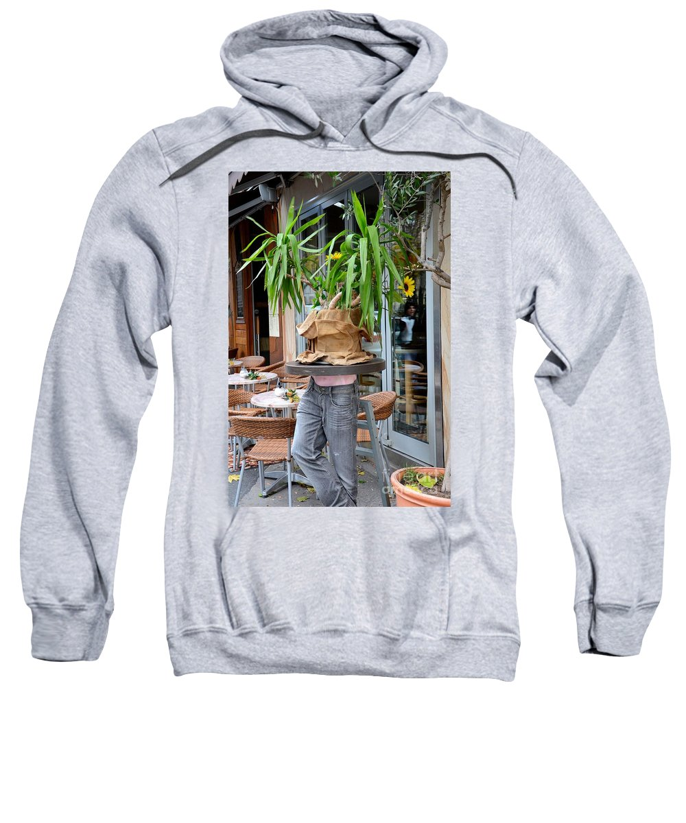 Table Sweatshirt featuring the photograph Plant And Table Top Rests On Mannequin by Imran Ahmed