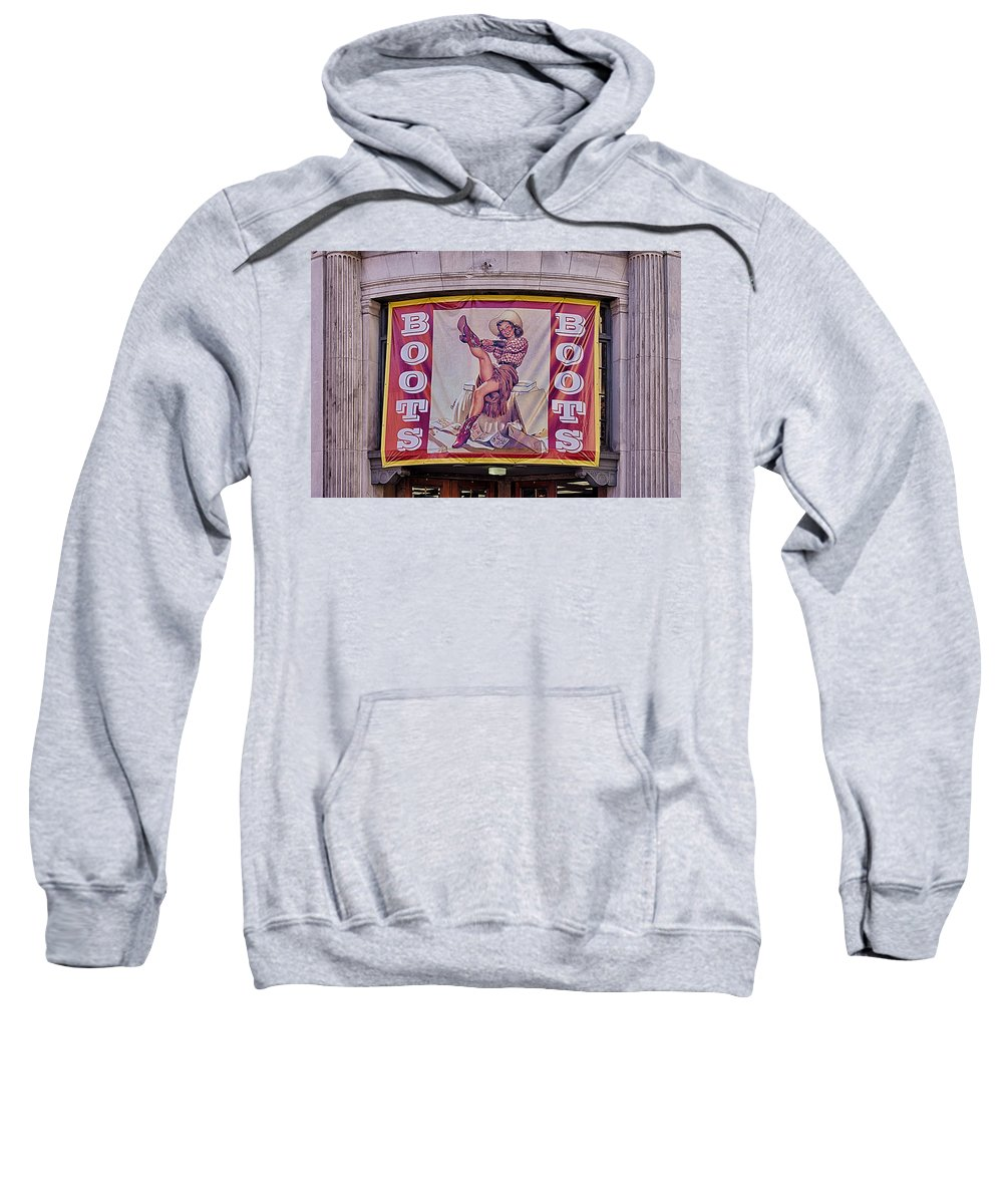 Nashville Sweatshirt featuring the photograph Pulling On Her Boots In Nashville by Priscilla Burgers