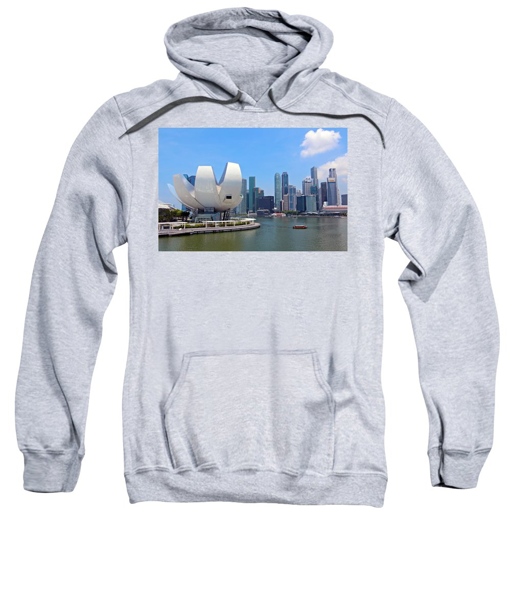 Singapore Sweatshirt featuring the photograph Singapore Artscience Museum And City Skyline by Paul Fell