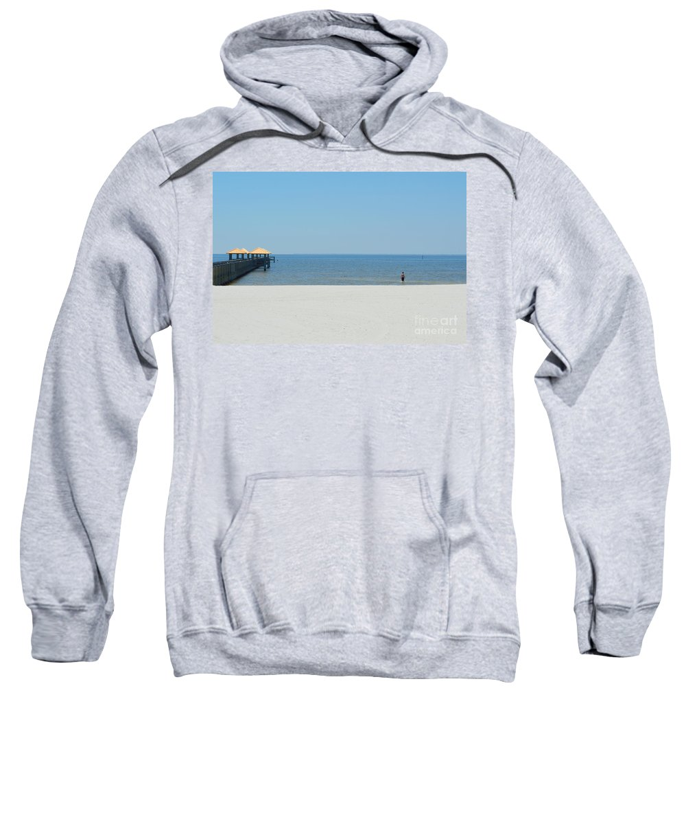 West Side Pier Sweatshirt featuring the photograph The Lone Swimmer by Alys Caviness-Gober