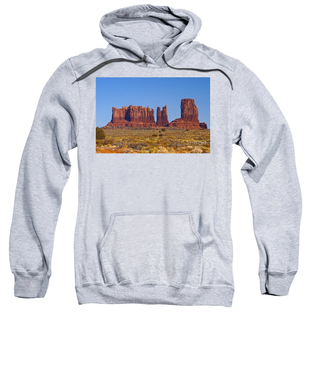 Monument Valley Utah Natural Monuments Mitten Mittens Rock Formation Formation Sunrise Sunrises Sandstone Monolith Monoliths Landscape Landscapes Sweatshirt featuring the photograph Valley Monuments by Bob Phillips