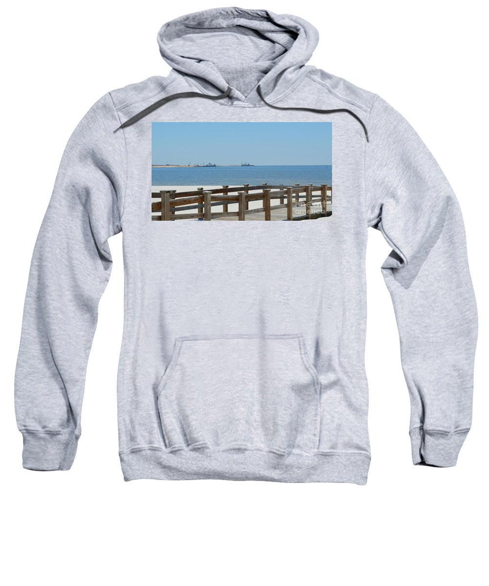 West Side Pier Sweatshirt featuring the photograph West Side Pier 1 by Alys Caviness-Gober