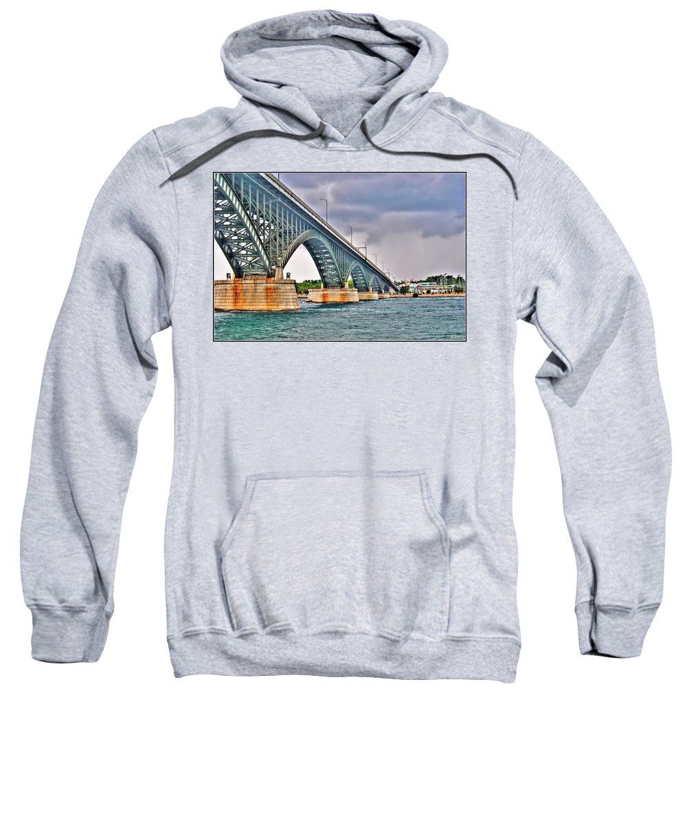 Sweatshirt featuring the photograph 001 Stormy Skies Peace Bridge Series by Michael Frank Jr