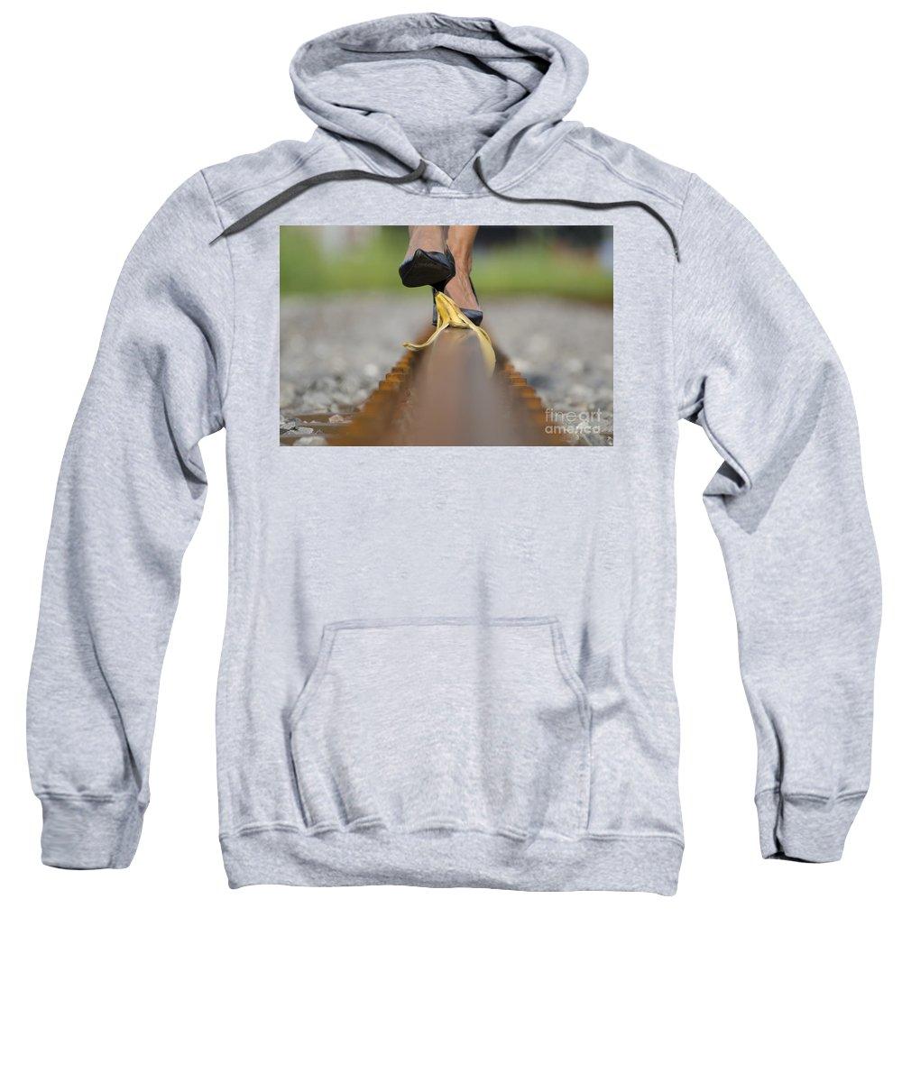 Banana Peel Sweatshirt featuring the photograph Banana Peel On The Railroad Tracks by Mats Silvan