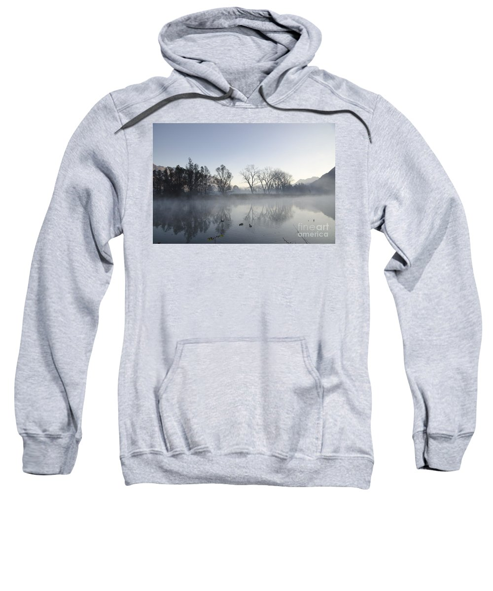 Lake Sweatshirt featuring the photograph Mountain And Trees Reflected In A Foggy Lake by Mats Silvan