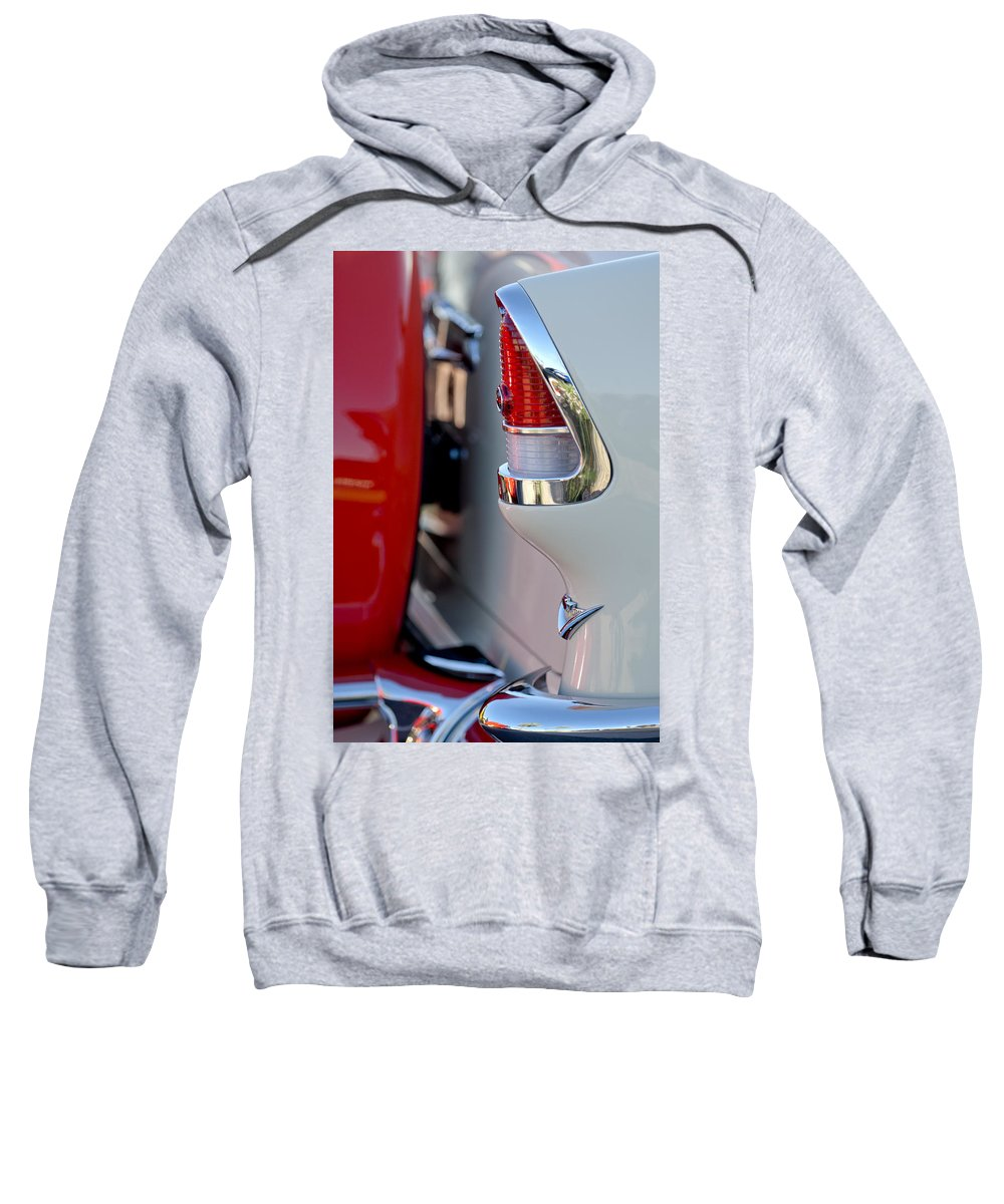 1955 Chevrolet Belair Sweatshirt featuring the photograph 1955 Chevrolet Belair Taillight Emblem by Jill Reger