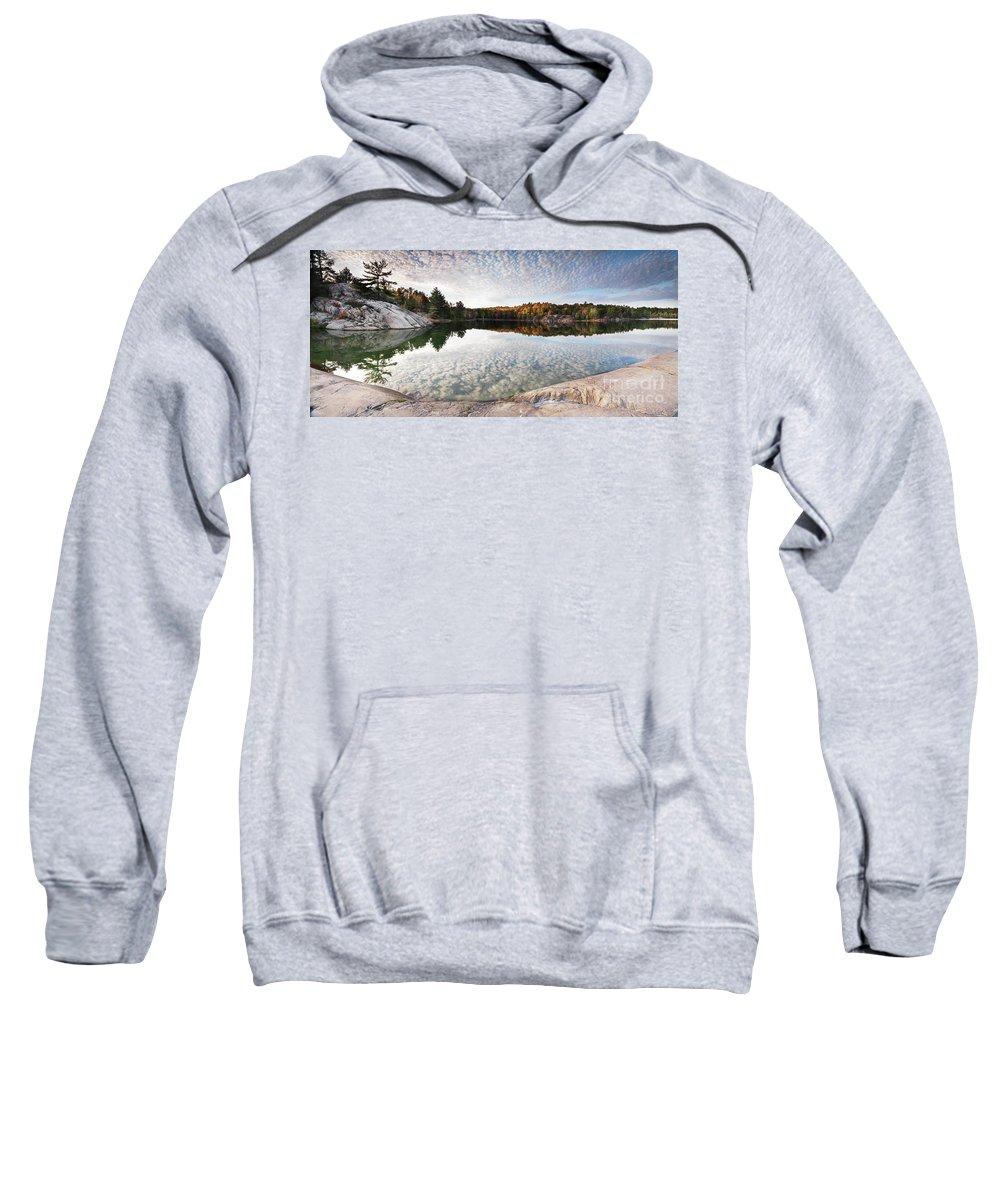 Lake Sweatshirt featuring the photograph Autumn Nature Lake Rocks And Trees Panorama by Oleksiy Maksymenko