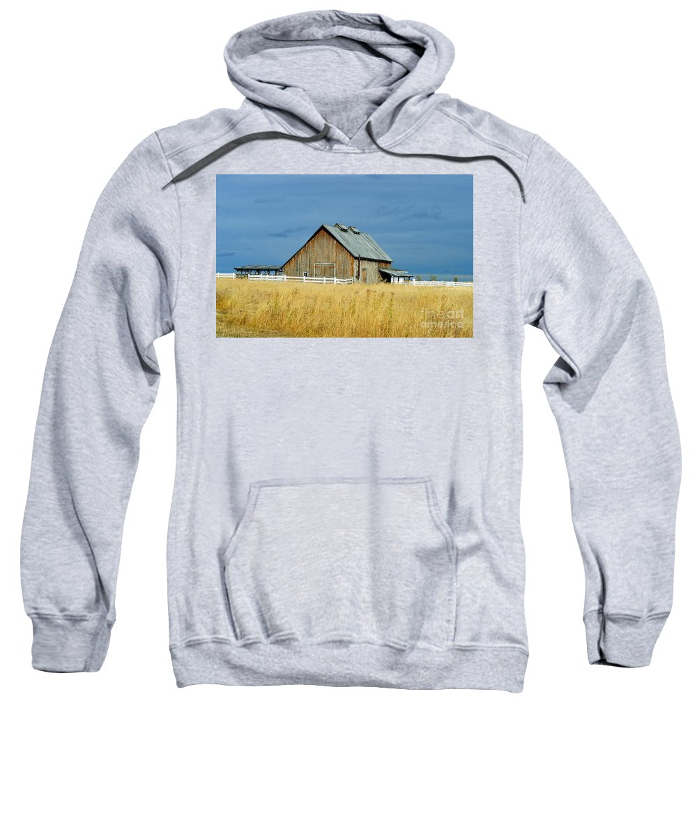 Old Barn Sweatshirt featuring the photograph Barn With Stormy Skies by Randy Harris