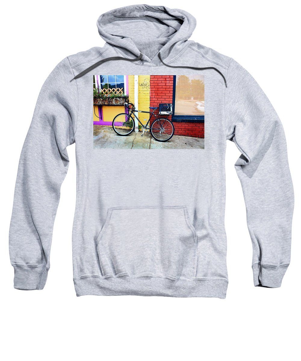 Bike Sweatshirt featuring the photograph Bike Leaning On The Colorful City Walls Of Asheville by Gray Artus