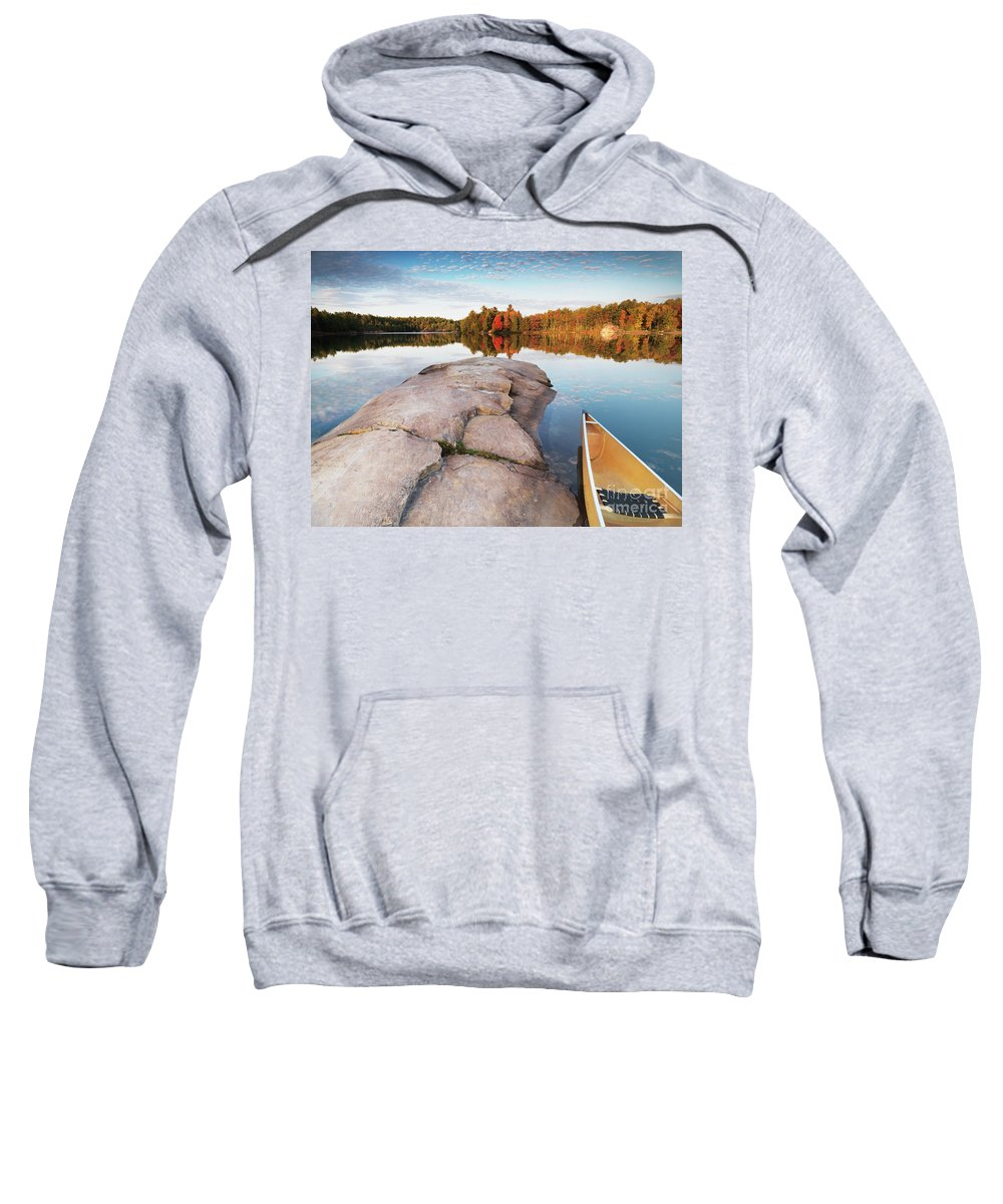 Canoe Sweatshirt featuring the photograph Canoe At A Rocky Shore Autumn Nature Scenery by Oleksiy Maksymenko