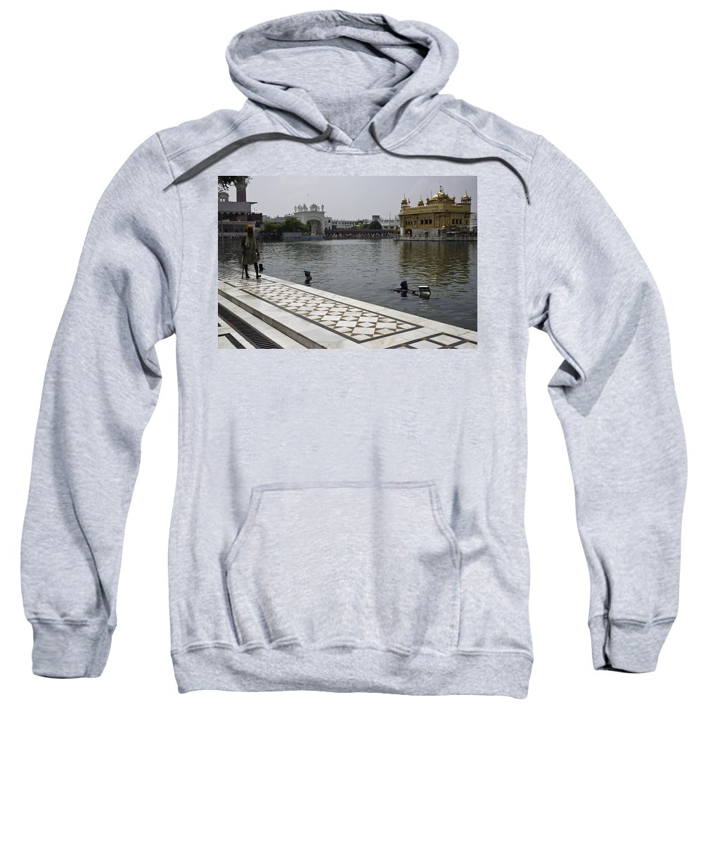 Sweatshirt featuring the photograph Clearing The Sarovar Inside The Golden Temple Resorvoir by Ashish Agarwal