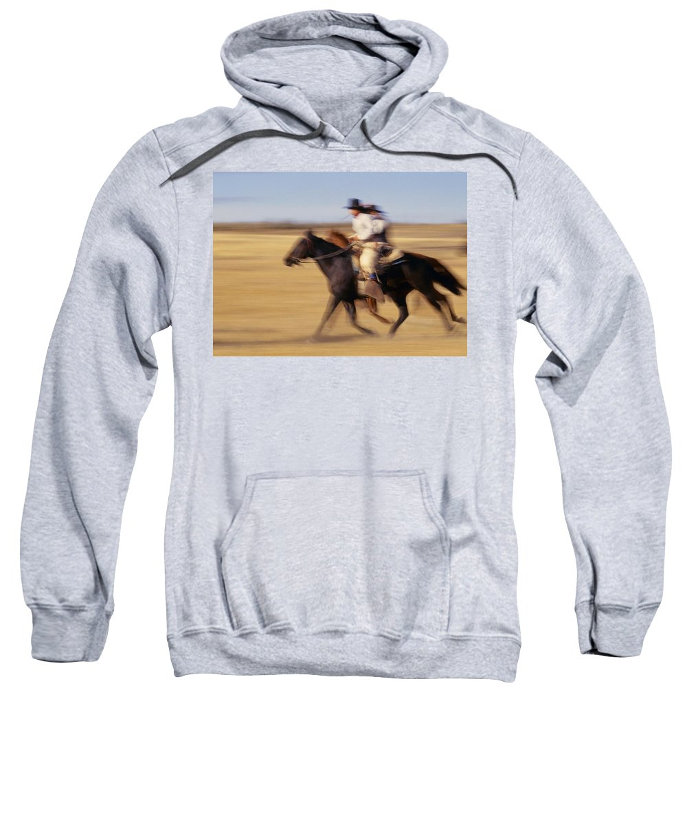 Outdoors Sweatshirt featuring the photograph Cowboys Racing Horses by Natural Selection Craig Tuttle
