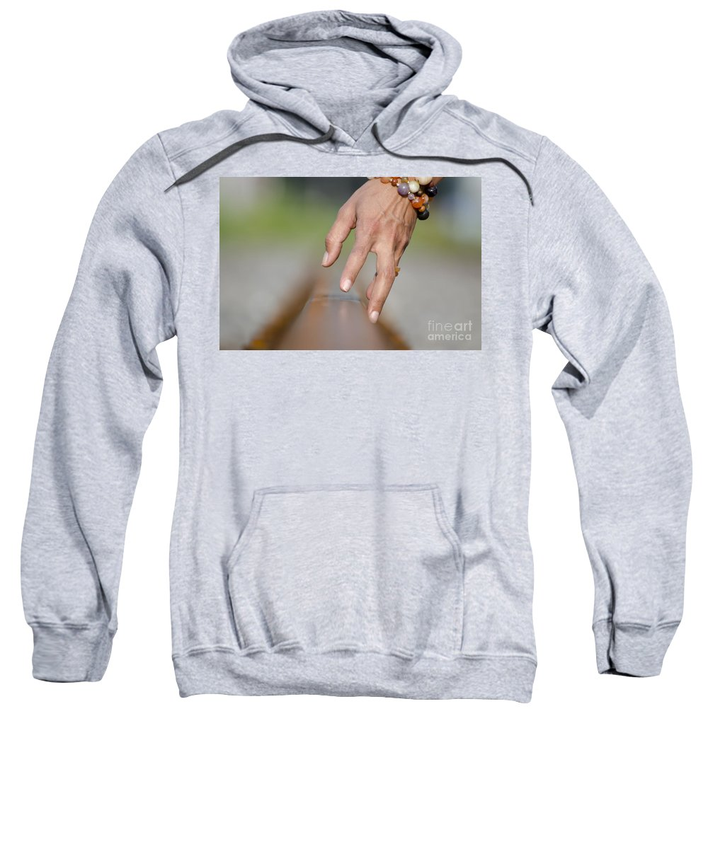 Hand Sweatshirt featuring the photograph Hand Touching A Railroad Track by Mats Silvan
