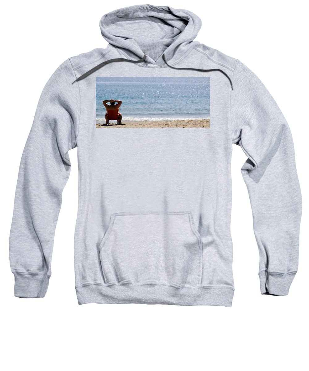 Man Sits On Chair On The Beach Sweatshirt featuring the photograph Man On Beach by Cliff Norton