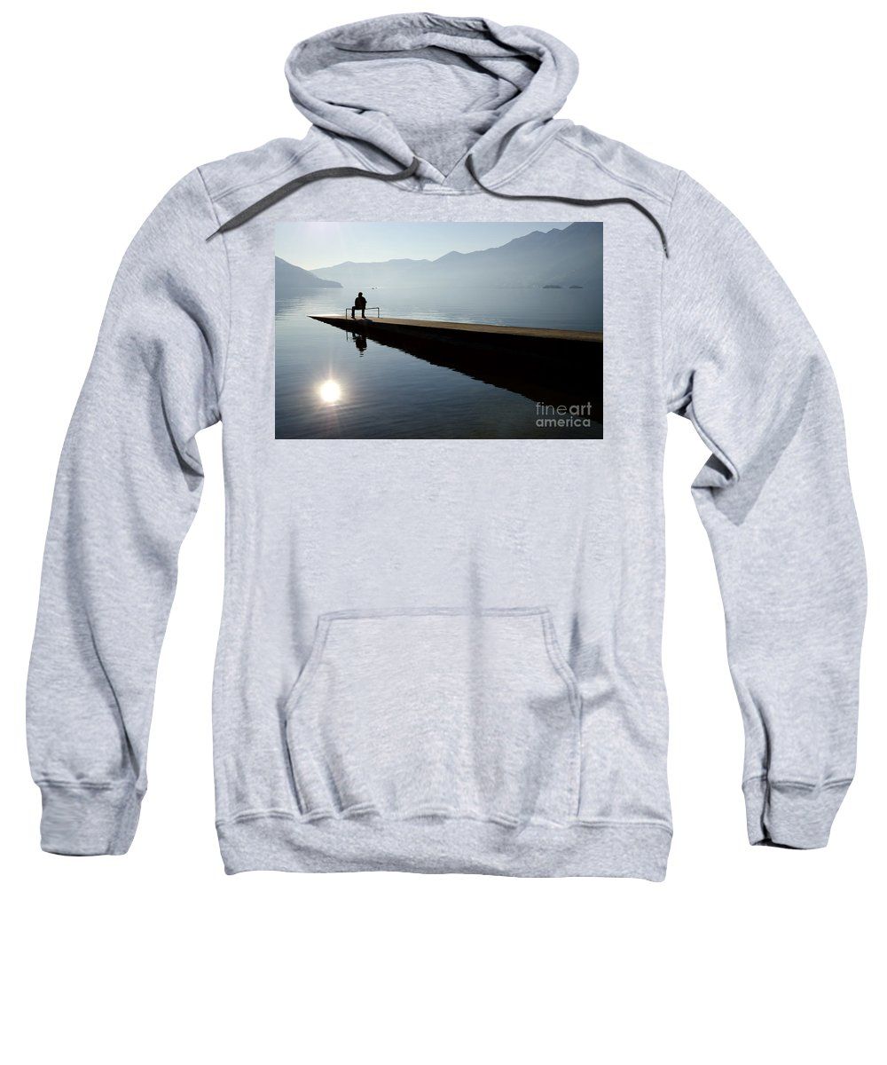 Man Sweatshirt featuring the photograph Man Sitting On The Pier by Mats Silvan