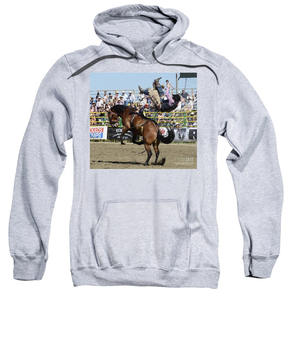 Rodeo Bareback Sweatshirt featuring the photograph Rodeo Off In A Flash by Bob Christopher