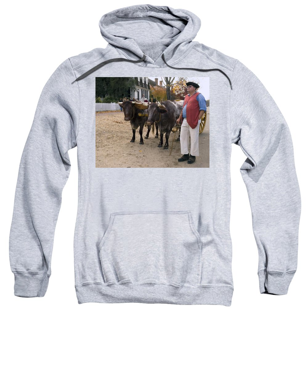 2 Oxen Walking Duke Of Glouster Street Sweatshirt featuring the photograph Oxen And Handler by Sally Weigand
