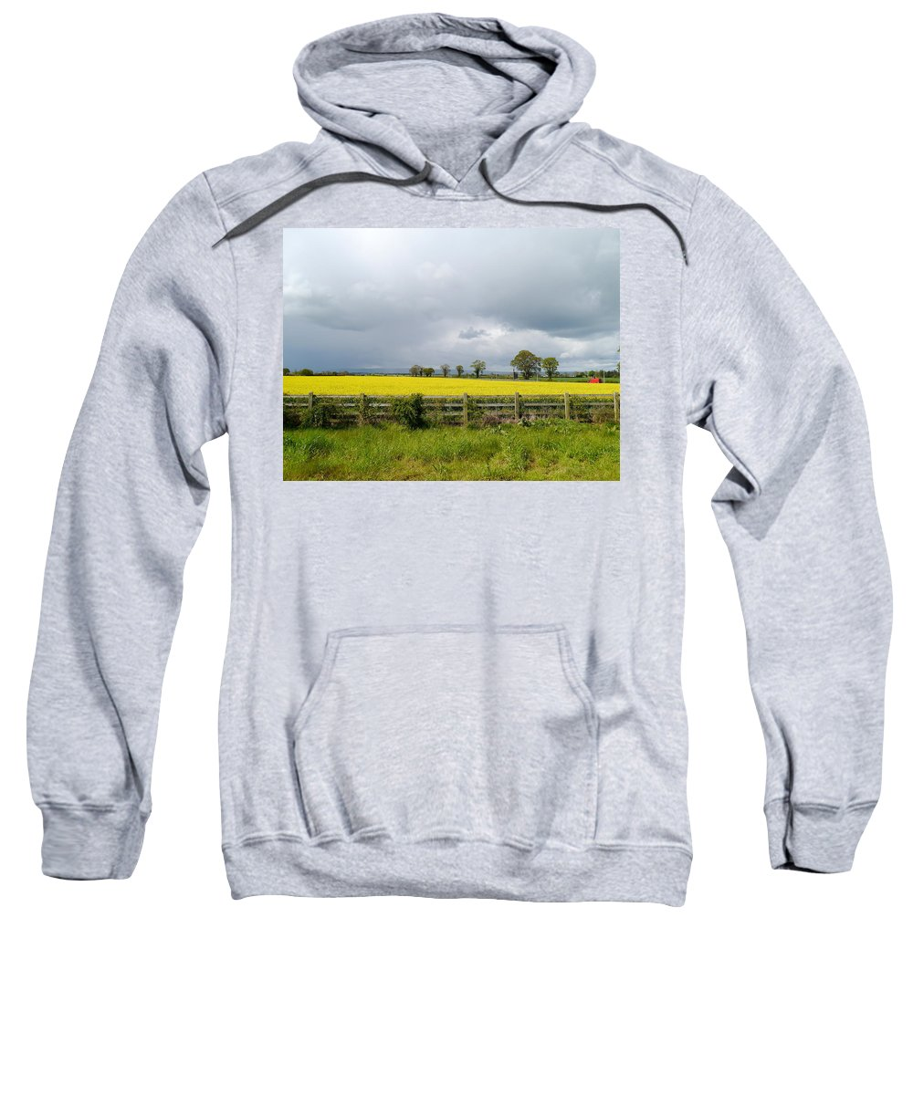 Canola Field Sweatshirt featuring the photograph Rain Clouds Over Canola Field by Christiane Schulze Art And Photography
