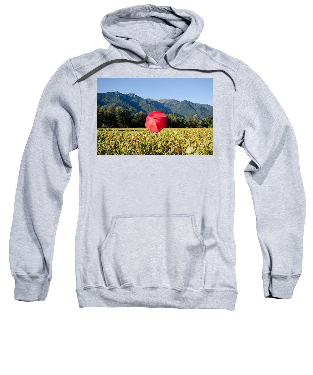 Red Sweatshirt featuring the photograph Red Umbrella On The Field by Mats Silvan