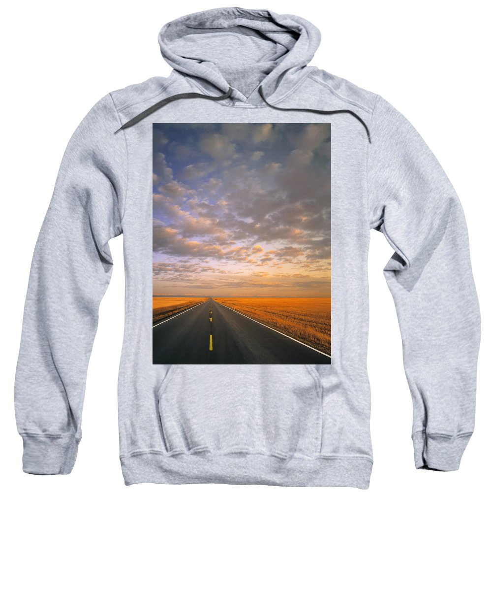 Light Sweatshirt featuring the photograph Road Into Sunset by Darwin Wiggett