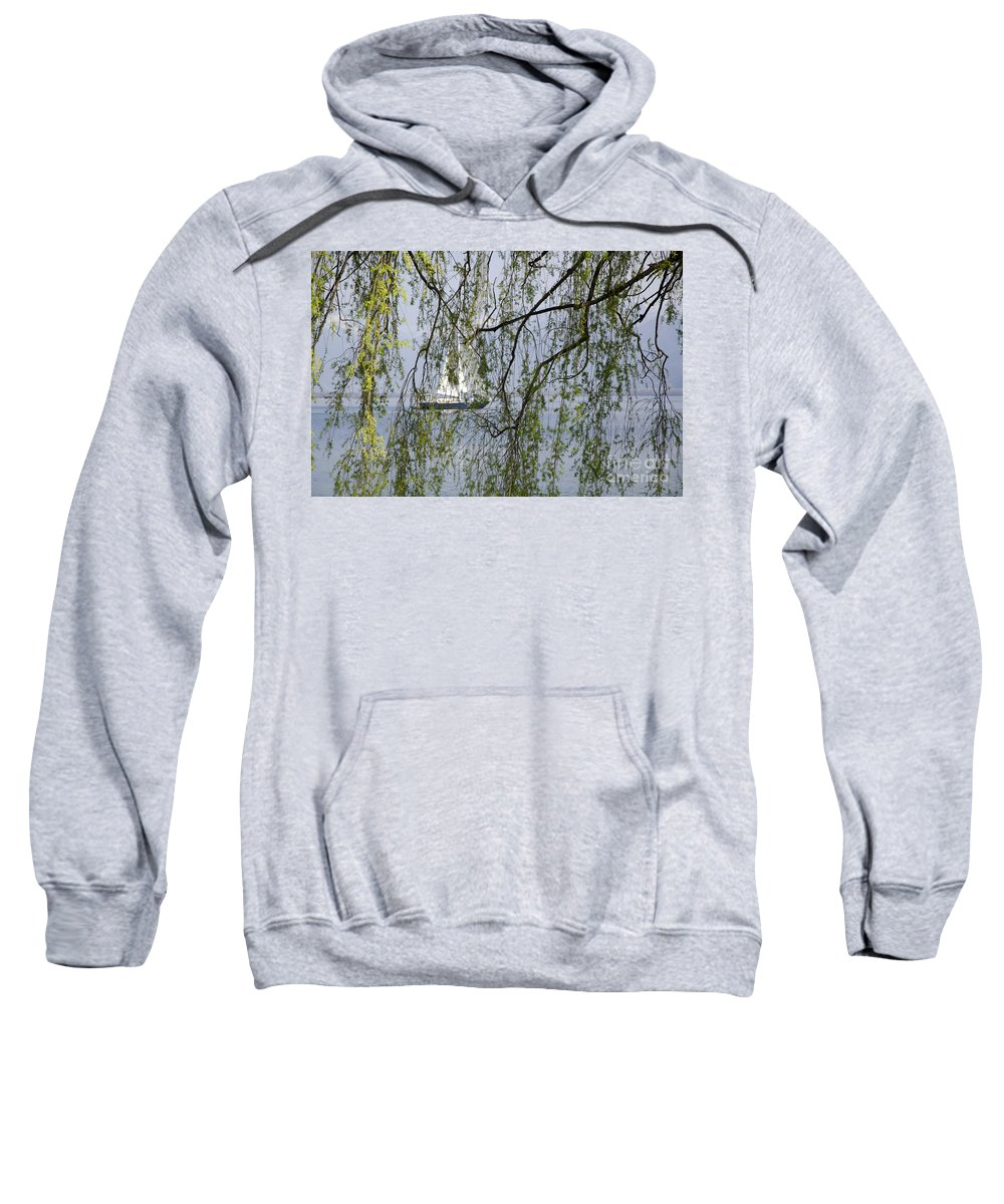 Boat Sweatshirt featuring the photograph Sailing Boat Behind Tree Branches by Mats Silvan