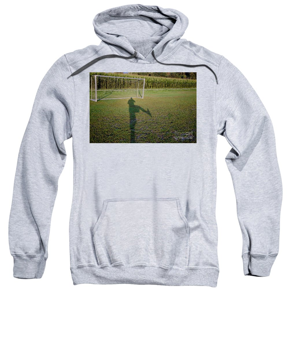 Football Sweatshirt featuring the photograph Shadow From A Football Player by Mats Silvan