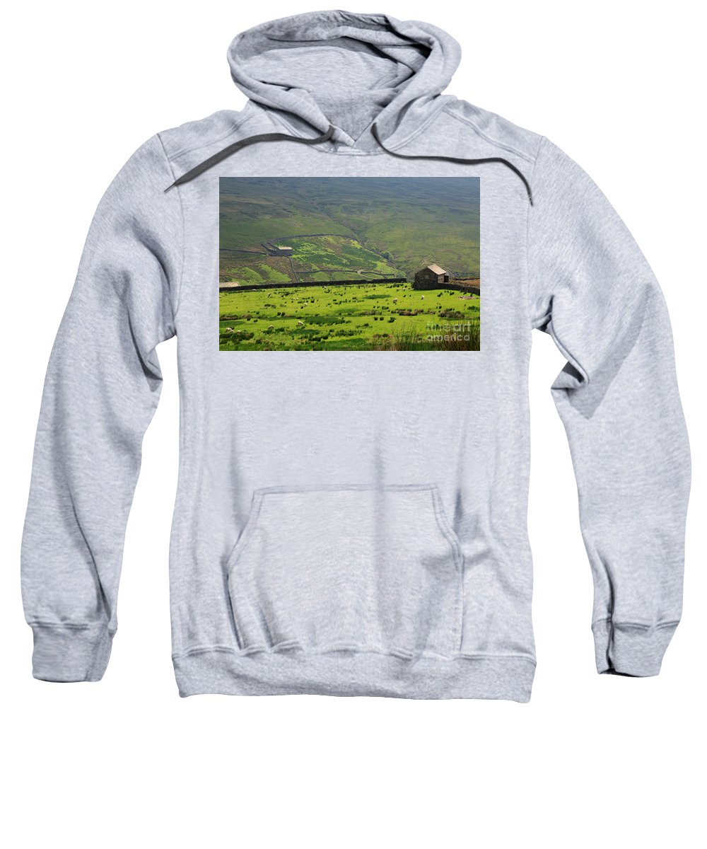 Field Sweatshirt featuring the photograph Sheep Graze In A Pasture In Swaledale by Louise Heusinkveld