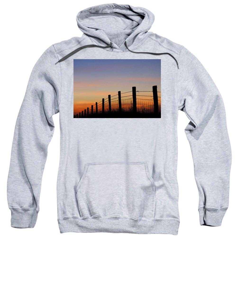 Barbed Wire Sweatshirt featuring the photograph Silhouette Of Barbed Wire Fence by Ross Hoddinott