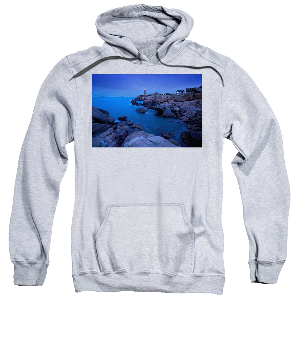 Water Sweatshirt featuring the photograph Small Lighthouse And House At Dusk by Axiom Photographic