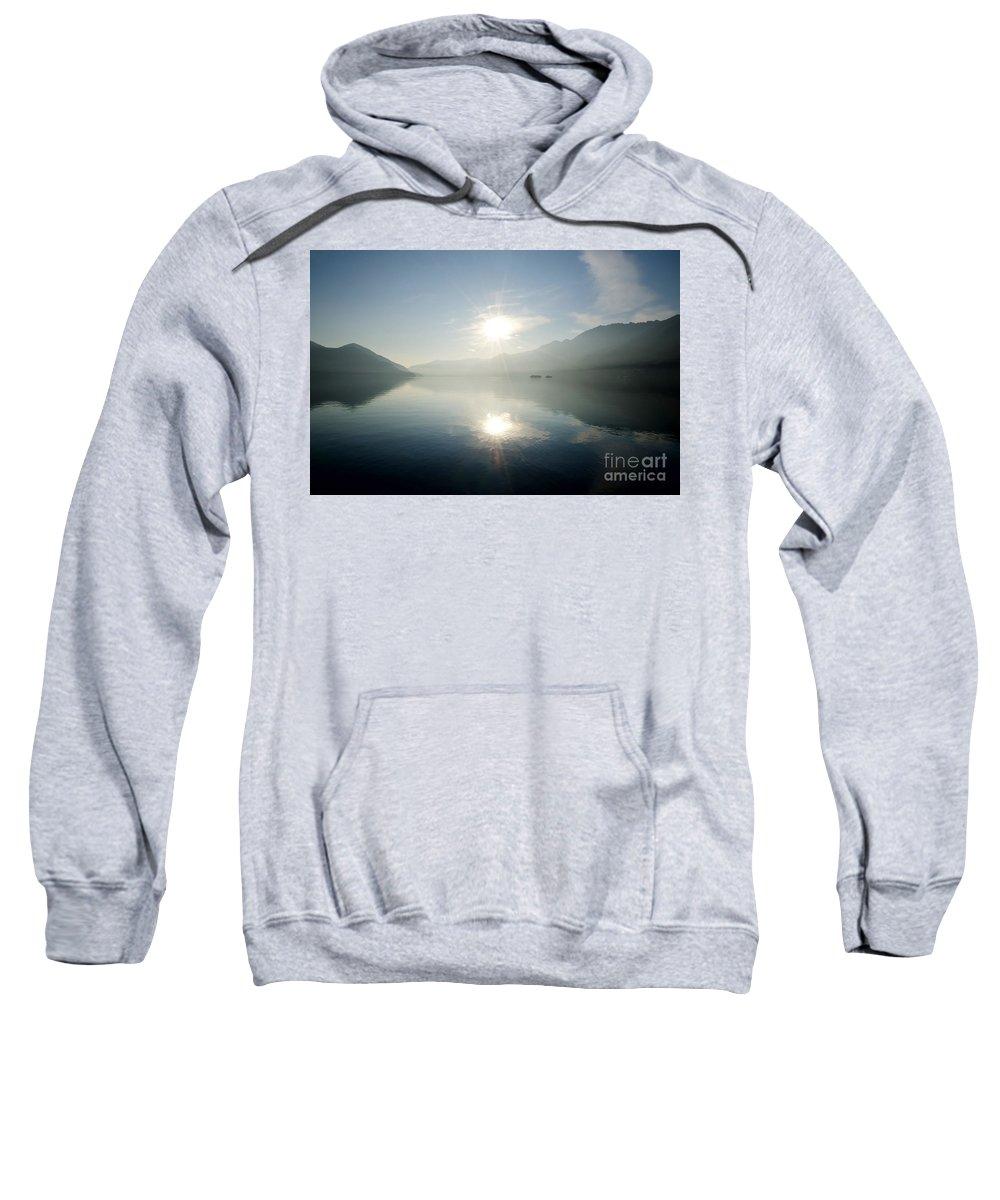 Sun Sweatshirt featuring the photograph Sun Reflections On A Lake by Mats Silvan