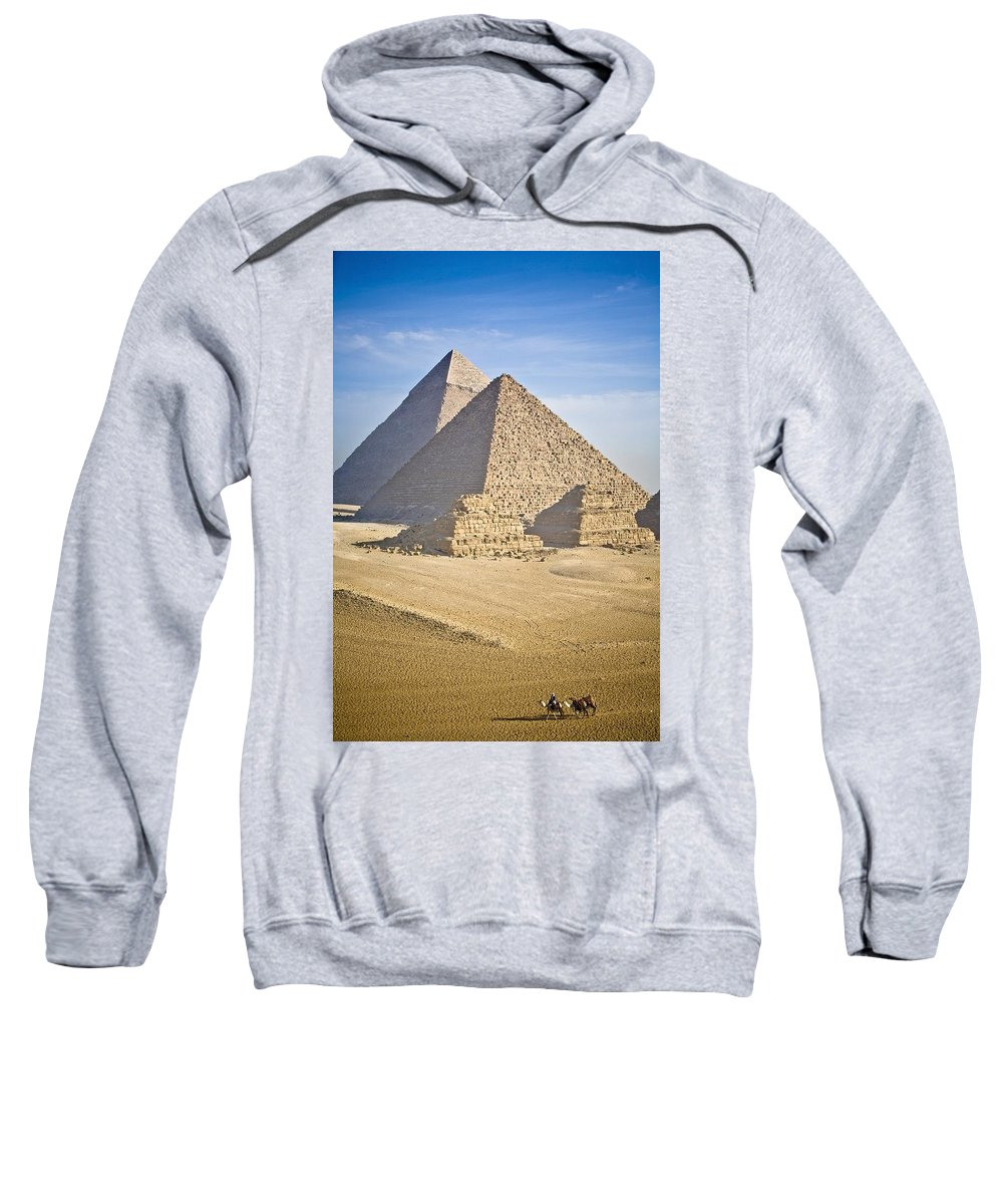 Ancient Sweatshirt featuring the photograph The Pyramids With Two Men On Camels by David DuChemin