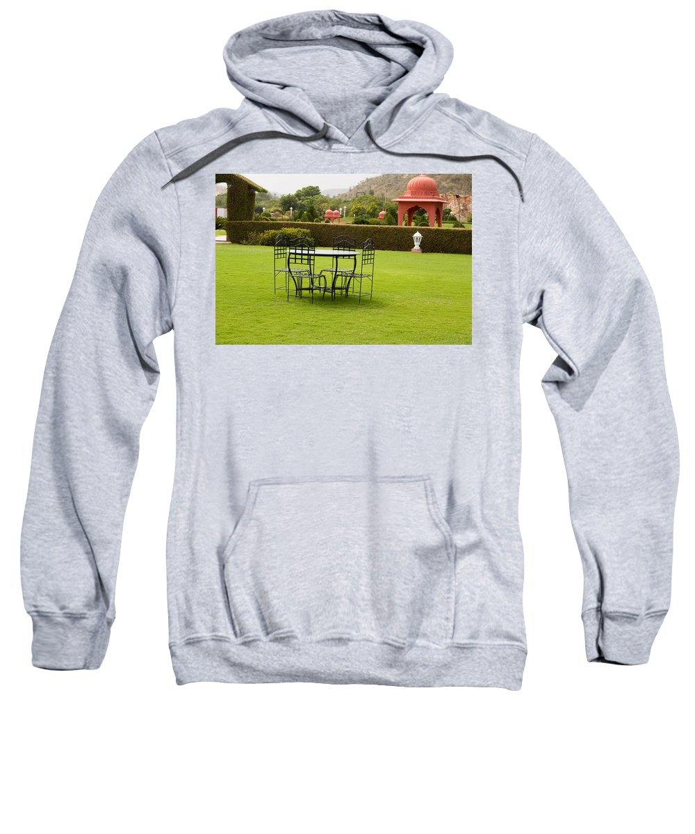 India Sweatshirt featuring the photograph Wrought Metal Chairs Around A Table In A Lawn by Ashish Agarwal