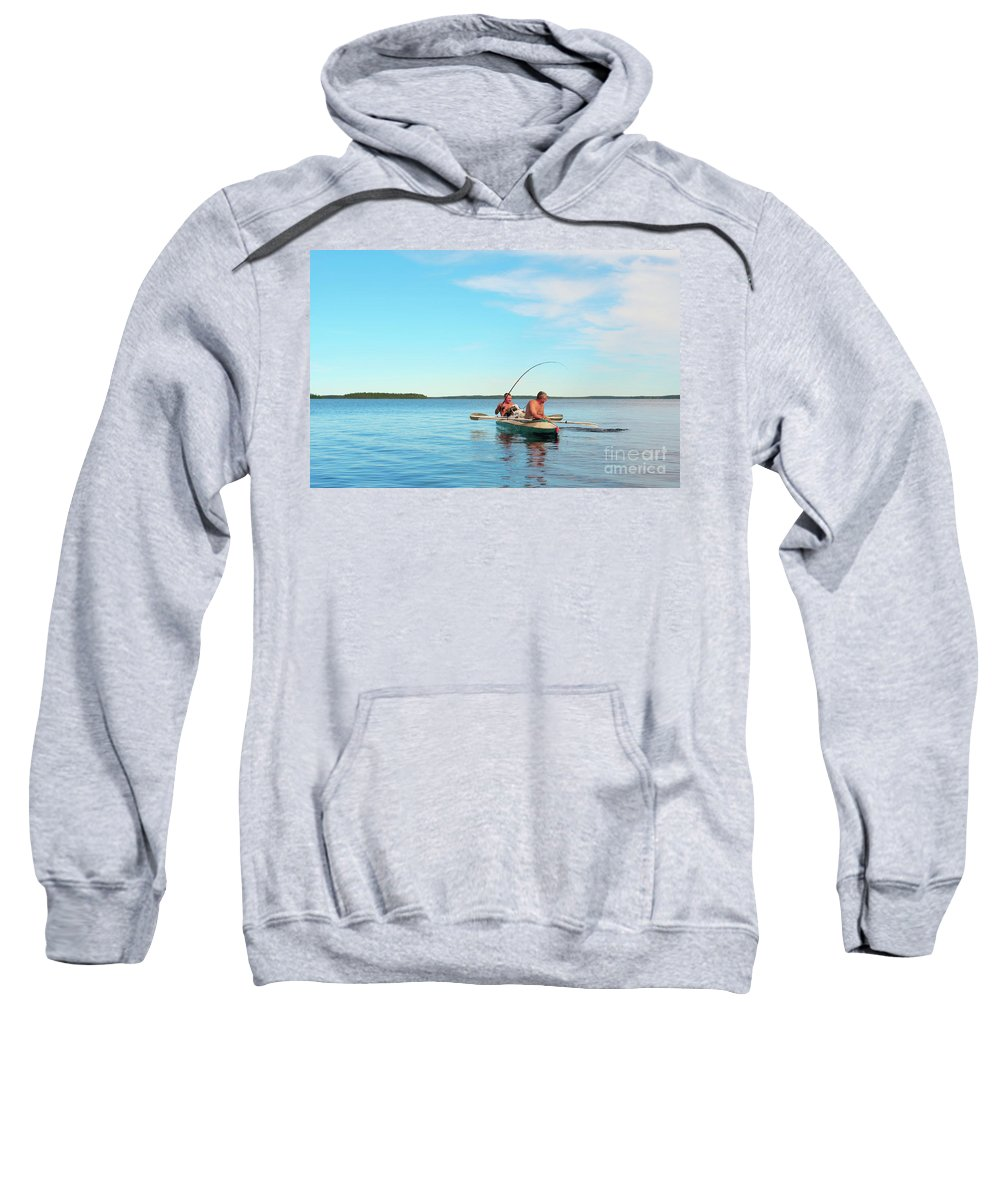 Beautiful Sweatshirt featuring the photograph Canoe Fishing On Blue Lake by Vadzim Kandratsenkau