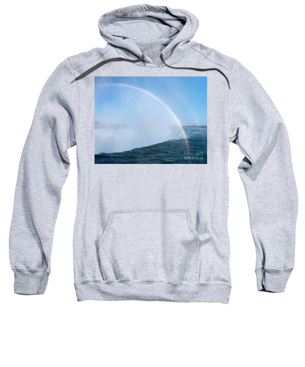 Niagara Falls Sweatshirt featuring the photograph Rainbow Over Niagara Falls Horseshoe Waterfall by Oleksiy Maksymenko