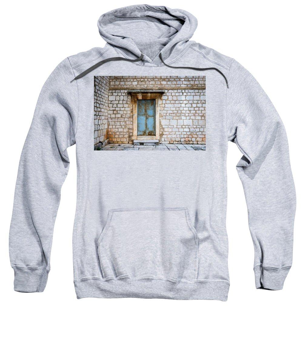 Door Sweatshirt featuring the photograph Closed Door Of An Old Chapel In Croatia by Stefan Rotter
