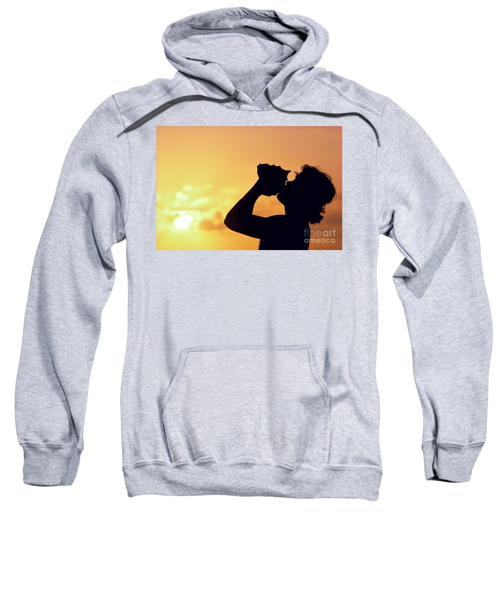 Aloha Sweatshirt featuring the photograph Conch Shell Blower by William Waterfall - Printscapes