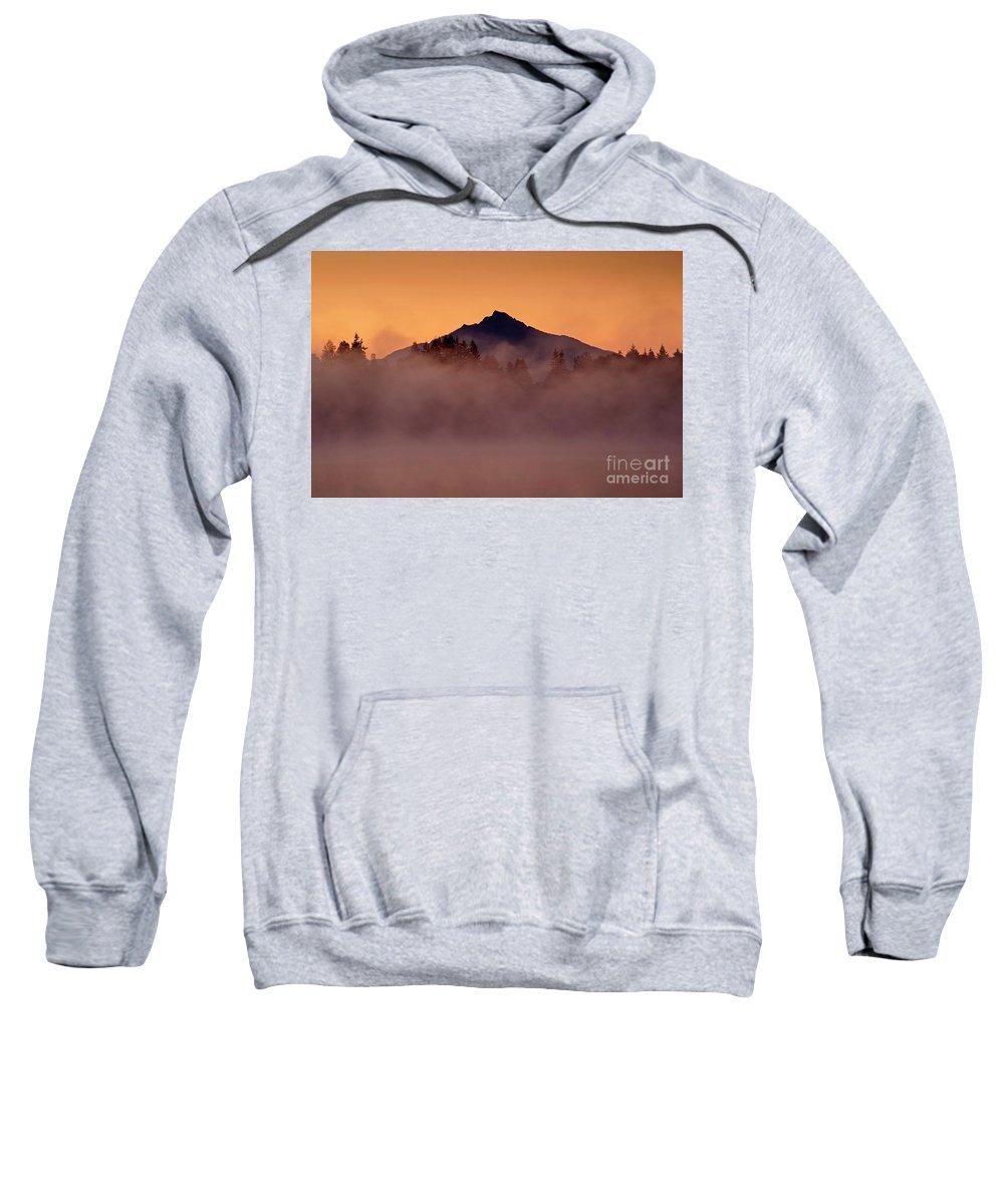 Cascade Mountain Range Sweatshirt featuring the photograph Mount Pilchuck Sunrise With Fog by Jim Corwin