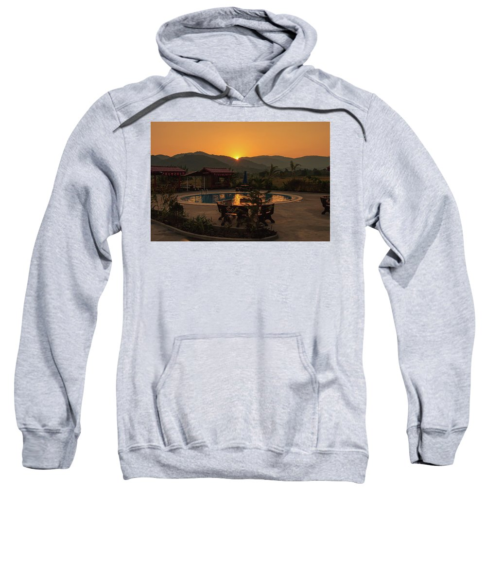 Golden Sweatshirt featuring the photograph A Golden Sunset In Loas by Nathaniel H Broughton