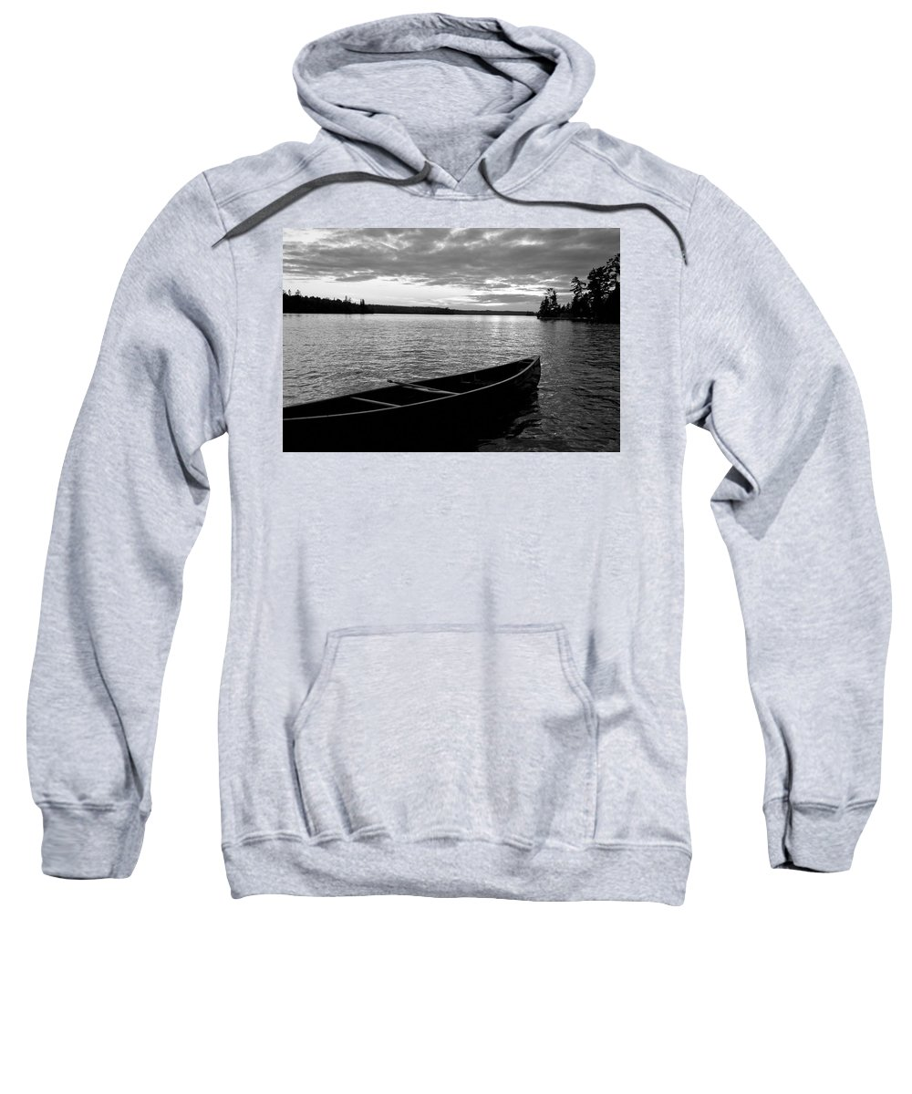 Absence Sweatshirt featuring the photograph Abandoned Canoe Floating On Water by Keith Levit