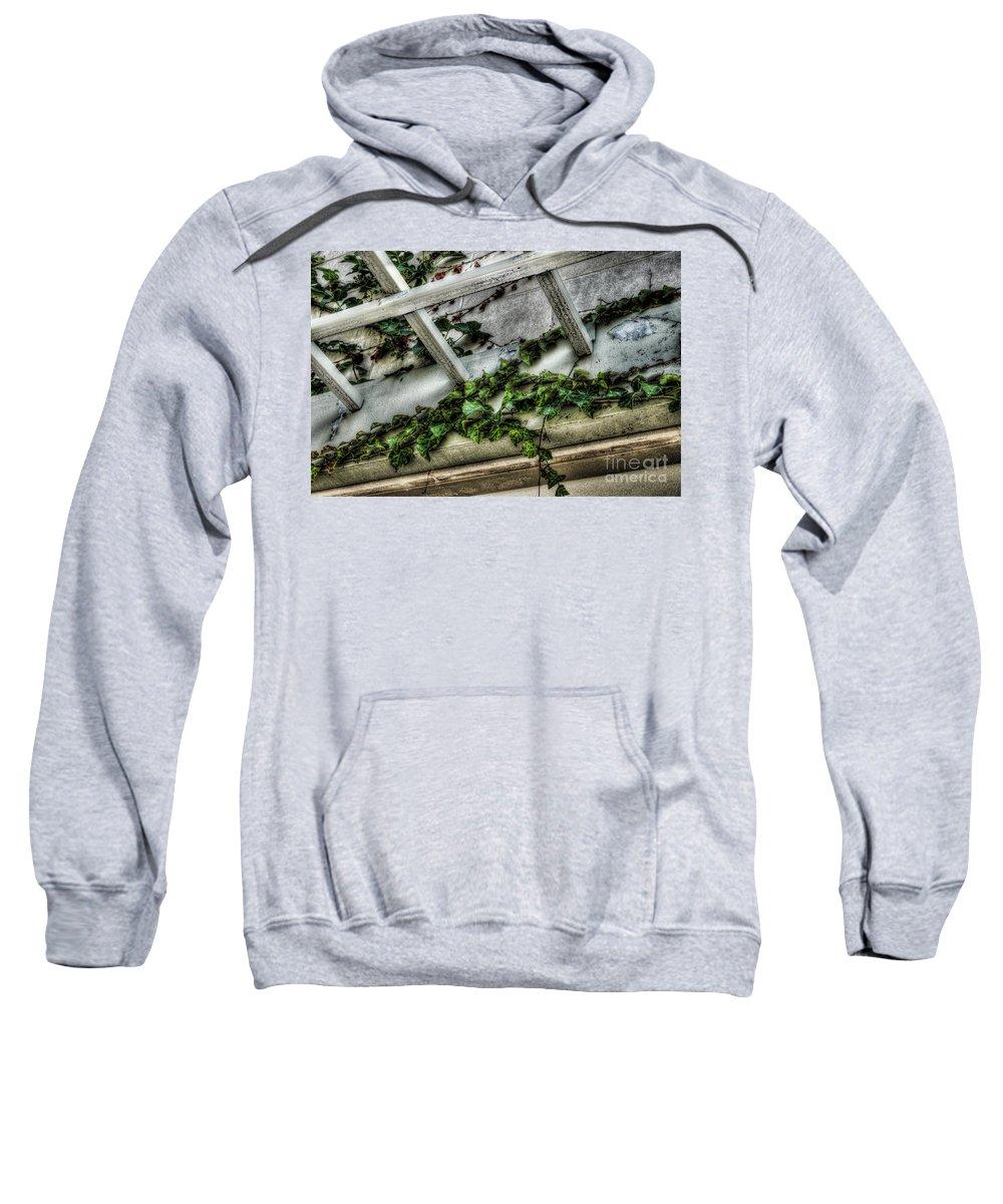 Above The Door Sweatshirt featuring the photograph Above The Door by Chris Fleming