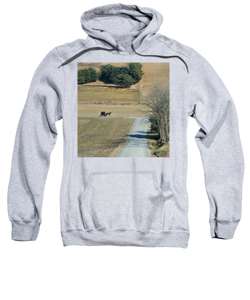 Amish Horse And Buggy In Ohio Sweatshirt featuring the photograph Amish Horse And Buggy On A Country Road by Dan Sproul