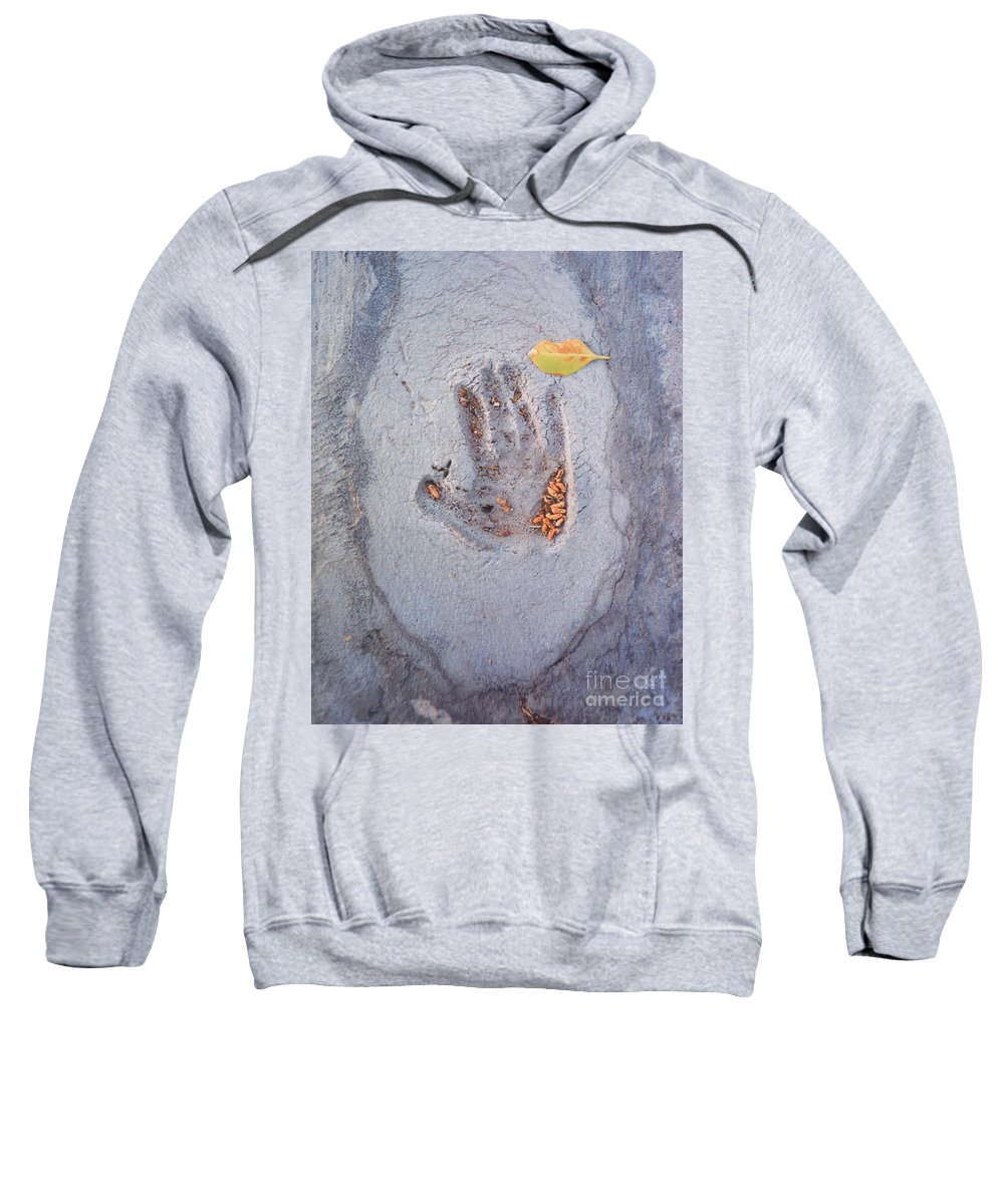 Sweatshirt featuring the photograph Autumns Child Or Hand In Concrete by Heather Kirk
