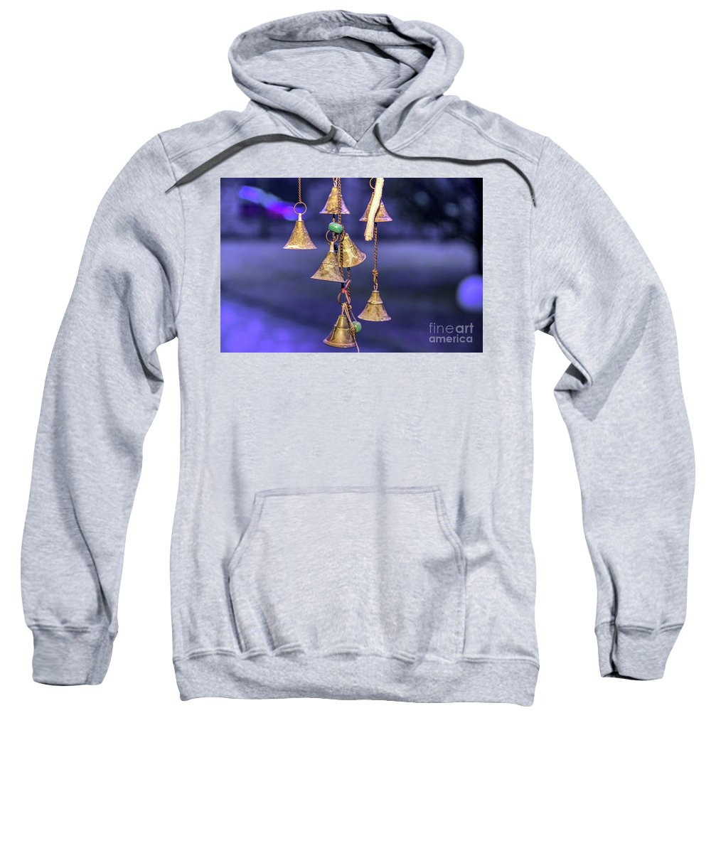 Objects Sweatshirt featuring the photograph Brass Bells Hanging In The Illuminated Courtyard At Winter Night by Bratislav Stefanovic