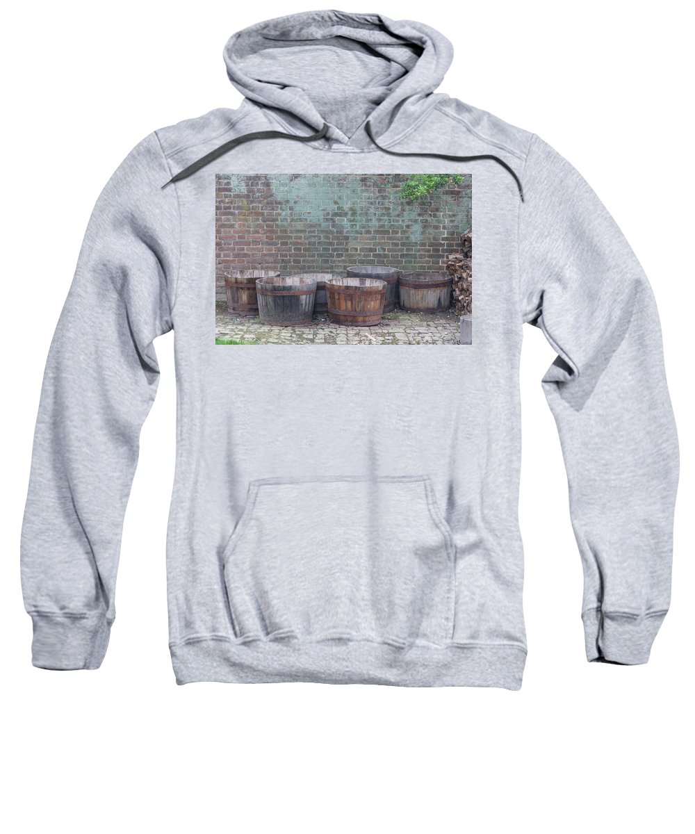 Colonial Williamsburg Sweatshirt featuring the photograph Brick Wall And Barrels by Teresa Mucha