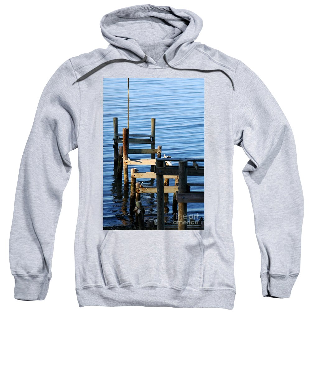 Clay Sweatshirt featuring the photograph Colonial Beach Pilings by Clayton Bruster